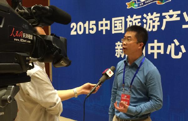 一块去旅行网CEO陈作智接受人民网采访